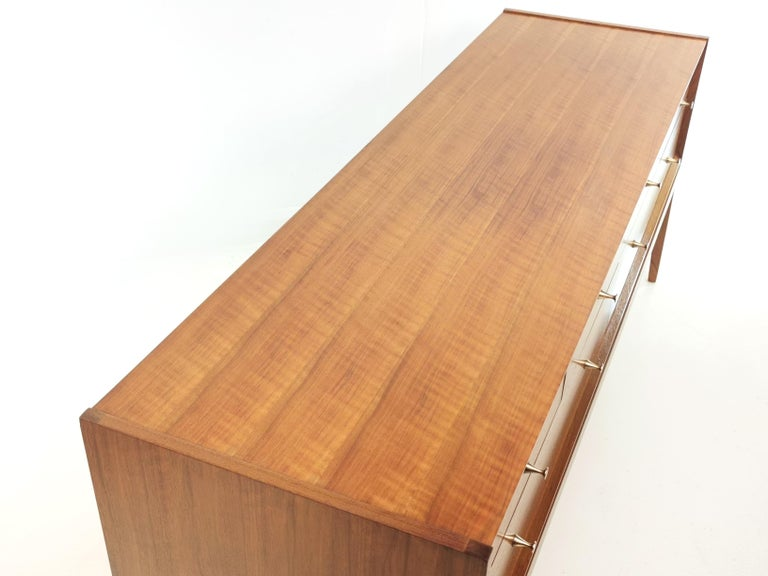 About this item Midcentury French walnut sideboard chest of drawers by John Herbert, 1960s  A younger chest of drawers, featuring six drawers with dovetail joints and brass handles, the whole unit is in French walnut.  A younger was a premium