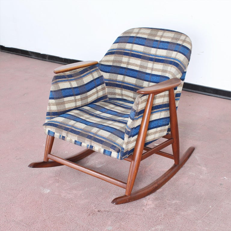 Elegant wooden rocking chair in blue tartan fabric, attribuited to Giangranco Frattini. Italy 1960s Wear consistent with age and use.