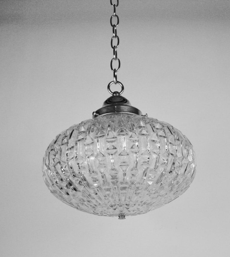 1-300ab midcentury ovoid shaped geometric glass pendant Size glass: 8 H x 12 W Two available Priced individually Supplied with 3 feet of chain and canopy.