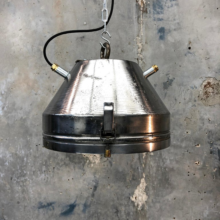 Iron and aluminium ceiling pendant with glass cover by VEB of Germany.