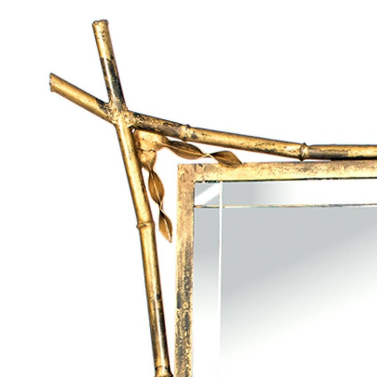 French gold gilded faux bamboo motif framed Etched mirror, circa 1960s, with curved cross corner.