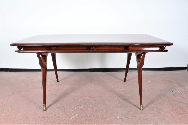 Elegant and prestigious rectangular table in brown wood, with beautiful and original spherical and animal-shaped decorative elements. By Giuseppe Anzani, Italy, 1950s The table has been restored. Wear consistent with age and use.