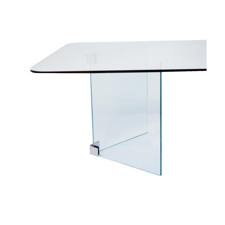 The plated metal fittings forming corner joints between two pieces of glass, with two supports at right angles for the to glass. Pace were the only company to make this type and style of table with right angles of metal with Allen screws to gently