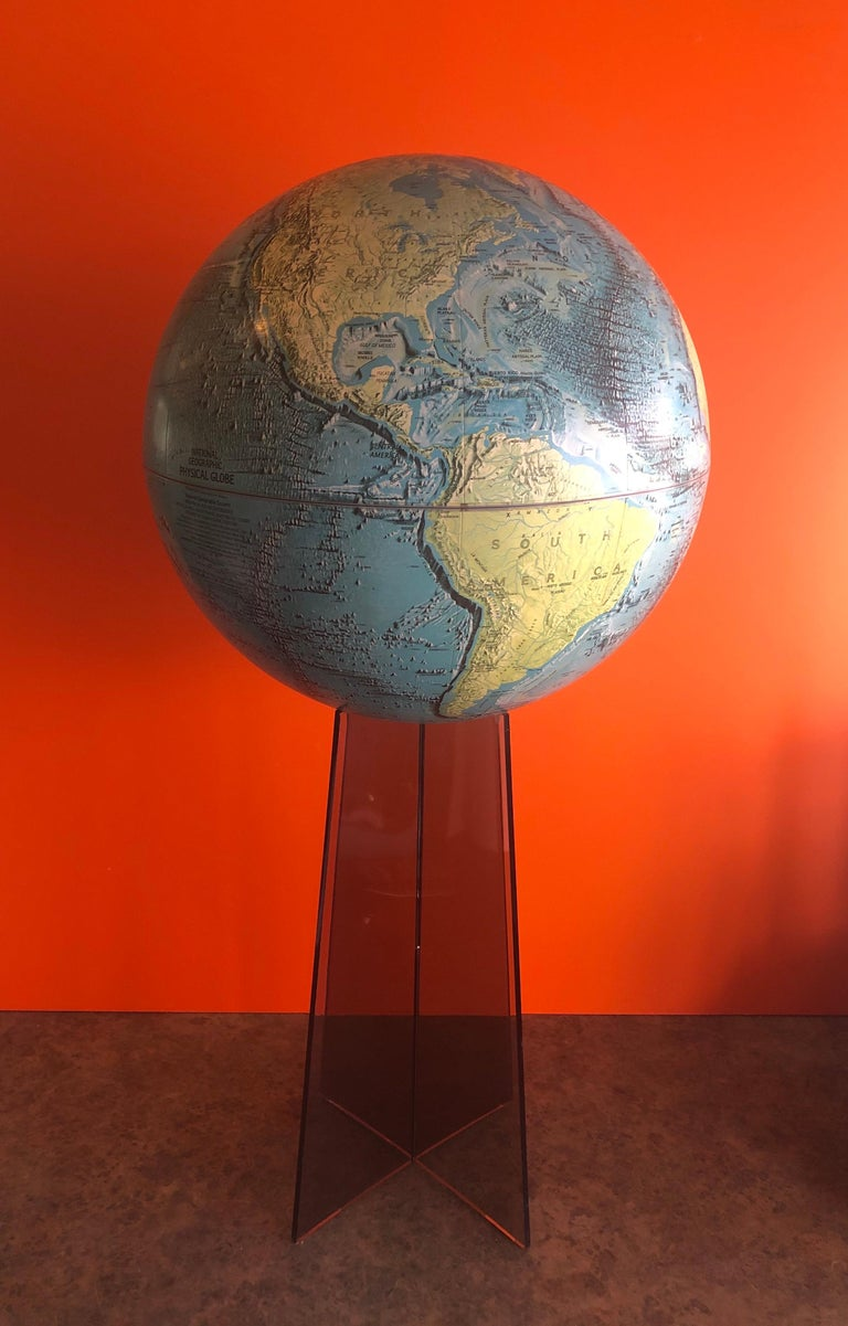 Large midcentury globe on smoked Lucite stand by National Geographic, circa 1970s. This a very cool piece with removable and super colorful 16