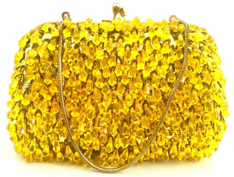 Mid-Century Gold Sequin & Hanging Bead Evening Bag By Walborg-Hong Kong. This coveted and rare evening bag features a hard case shell with hand sewn gold sequins at its base covering and cut and faceted gold Lucite chandelier style hanging beads.