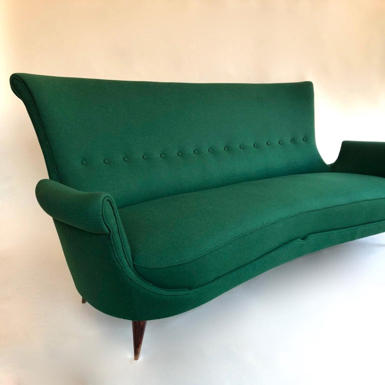 Stylish and comfortable midcentury green Italian sofa, 1950s, in the manner of Gio Ponti.