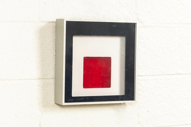 This original midcentury Greg Copeland three-dimensional art light box is signed and dated 1970. This rare configuration includes plug-in lamp. The modernist Op art design features black, white and red stacked acrylic layers forming an abstract,