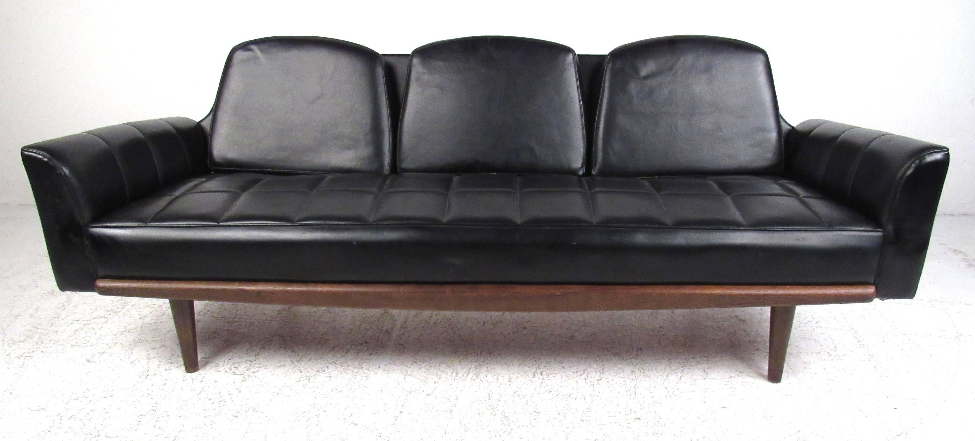 Classic Midcentury Black Vinyl Sofa Featuring A Grid Tufted Pattern Across  The Seats And Arms.