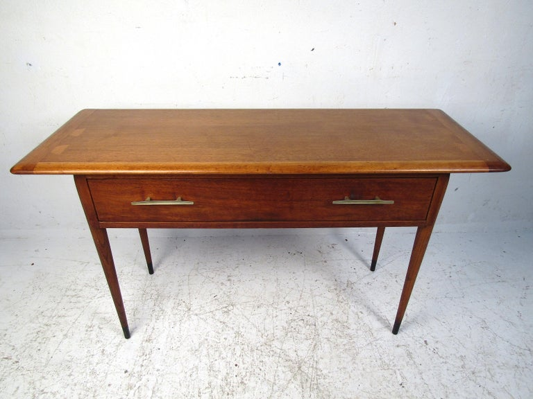 Stylish midcentury console table manufactured by Lane Furniture Co. Good-looking table with tapered legs, half-bowtie inlays on the edges of the tabletop, and dovetail jointed drawers. Please confirm item location with dealer (NJ or NY).