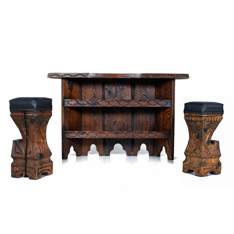 Take a walk on the wild side, or maybe just have a drink there, with this fabulous tiki bar by Witco. The bar and stools are substantial, manufactured of thick slabs of cedar wood. Each stool has been recovered in a high-quality, cruelty free,