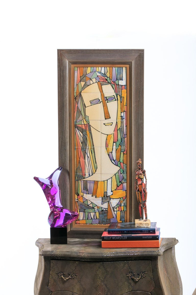 Harris Strong Mid-Century Modern portrait of a lady executed in ceramic tiles, framed, label on reverse side. Want to see more beautiful things? Scroll down below and click