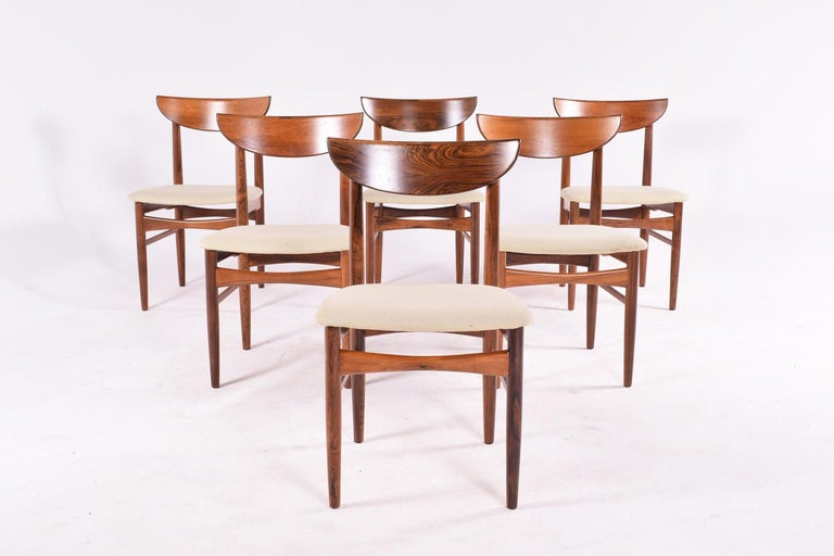 A set of 6 dining room chairs in rosewood designed by Harry Østergaard and manufactured in the 1960s by Randers Møbelfabrik, Denmark Delicate and solid craftsmanship with a vivid rosewood veneer. Set in excellent conditions.