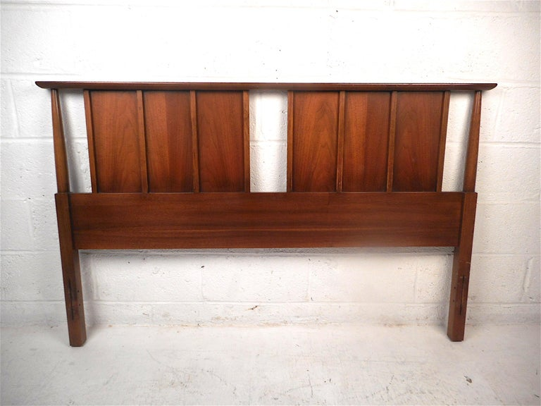 Stylish midcentury headboard and footboard. Sturdy construction with a dark walnut finish. Stylish tapered supports and vertical accents on the headboard. Great set sure to be a great addition to any modern interior. Rails not included. Made for a