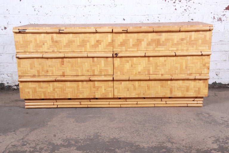 An exceptional Mid-Century Modern Hollywood Regency chinoiserie bamboo parquetry long dresser or credenza.  In the manner of Ficks Reed  USA, circa 1970s  Measures: 63.25