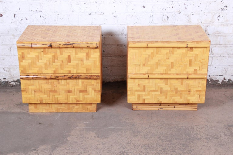 A gorgeous pair of Mid-Century Modern Hollywood Regency chinoiserie bamboo parquetry two-drawer nightstands or end tables