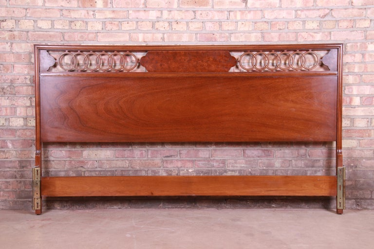 A gorgeousMid-Century Modern Hollywood Regency walnut and burl wood king size headboard  In the manner of Michael Taylor for Baker Furniture  USA, circa 1960s  Measures: 77.25