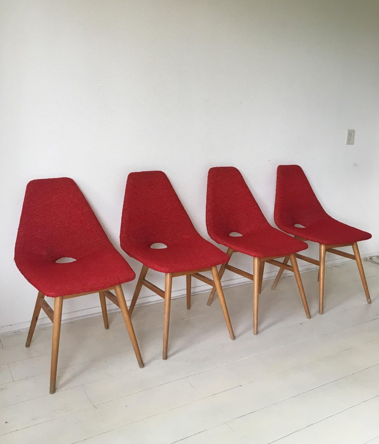 These stunning Hungarian chairs were designed by Judit Burian and Erika Szek in the 1950s. The chairs feature a beech base and flexible bentwood seating in original fabric. The chairs are in good condition but their base do show signs of age and use