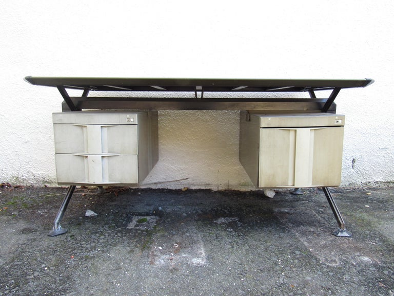 This impressive vintage modern desk boasts a floating top covered in faux textured leather. A stunning Italian Industrial Design that looks amazing in any setting. The metal frame has two hefty drawers on the right and a large filing drawer on the