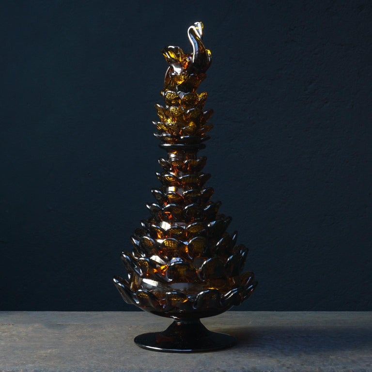 Very pretty, possibly Murano, amber colored 1950s Italian glass bottle in the shape of a large pinecone with bird or swan stopper. Mouth blown bottle decorated with glass 'scales' to form a pinecone shape. On the, also mouth blown, stopper, scales