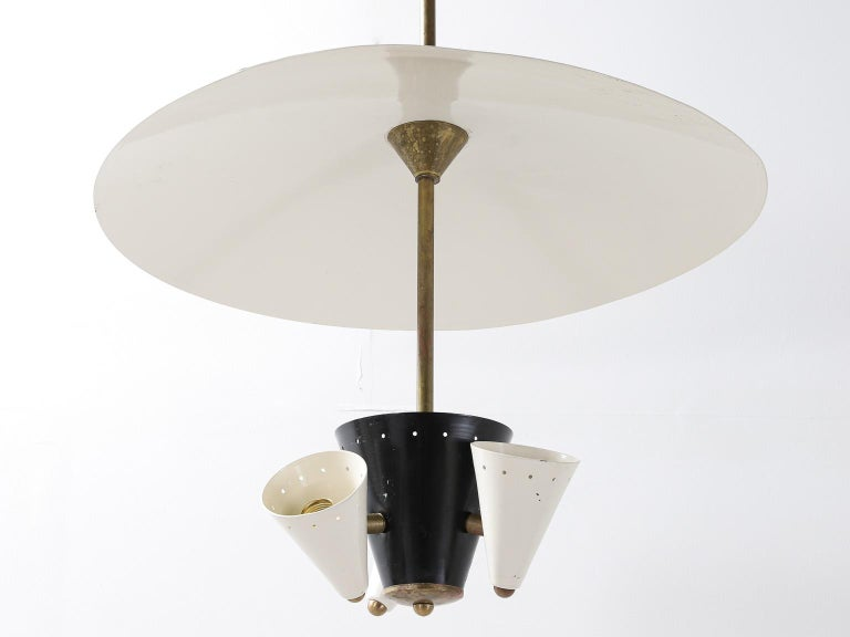 Midcentury Italian ceiling light and diffuser in black and white lacquered metal and brass structure.