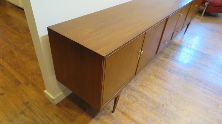 1950s Italian credenza long sideboard in the style of Ico Parisi. Italian midcentury server teak and rose wood very long 117 inches. Having three cabinet storage areas and two lower drawers. Floating splayed leg design very unique one of a kind