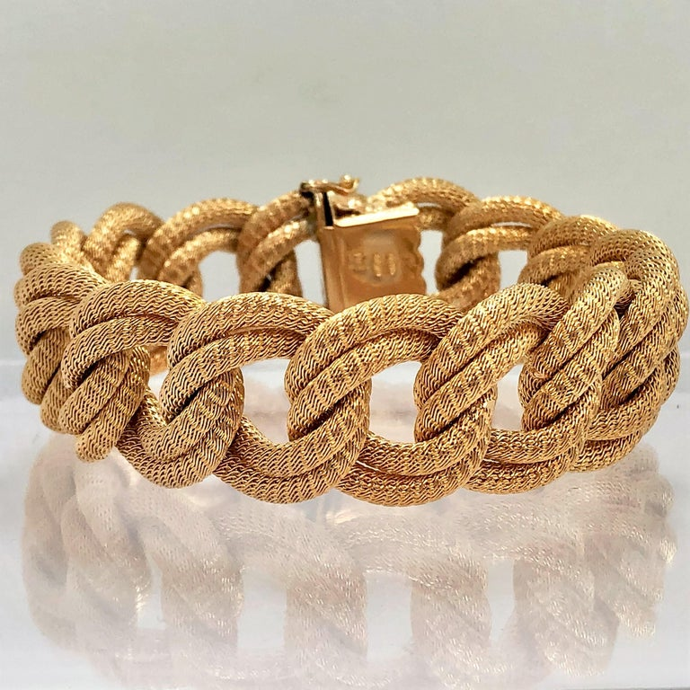 Made in the Verona region of Italy during the 1960's-1970's, this classic  18K Yellow Gold, woven mesh link bracelet is both graceful and elegant.  This is a fine example of the Italian gold weaving art. Measuring a full 7 1/2 inches long by just