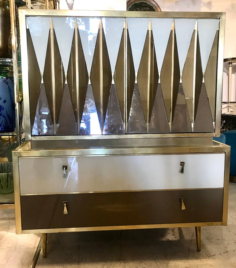 One of a kind, custom made Italian chest of drawers of glass and brass. This highly decorative piece of furniture enhances any room it's placed in.