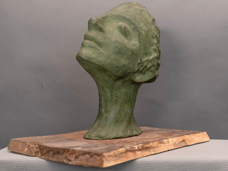 Plaster sculpture depicting a lovely young woman. Original wood base.