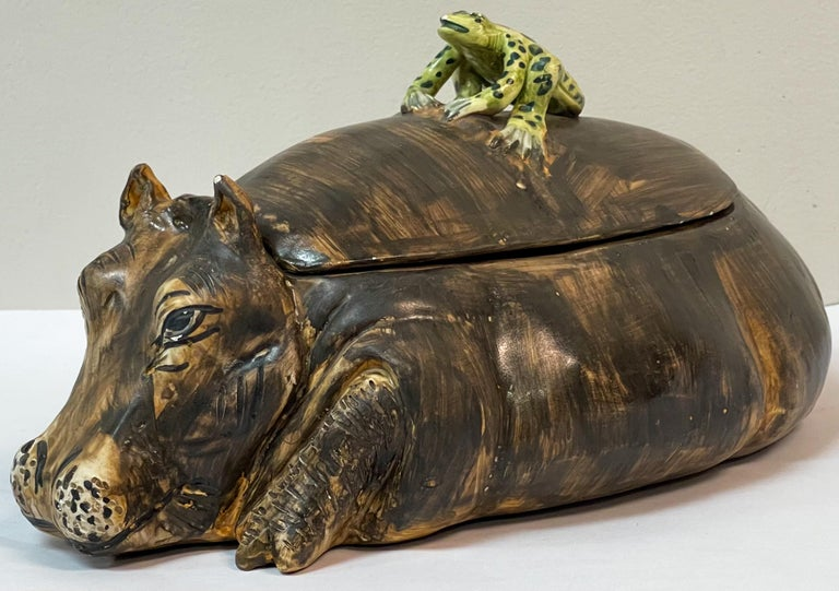 This is so fun for the holidays! It is a signed Italian hippo tureen with a small frog perched on it. It is on very good condition. The markings are an AG plus a coronet.