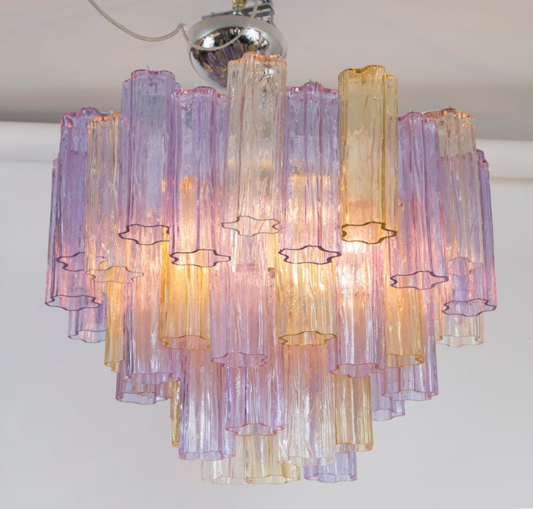 Mid-Century Modern tronchi chandelier or near flush-mount comprised of six graduated layers of lavender, fume and blush blown colored concentric tubes. Re-electrified with six medium base sockets for up to 60 watts each of incandescent