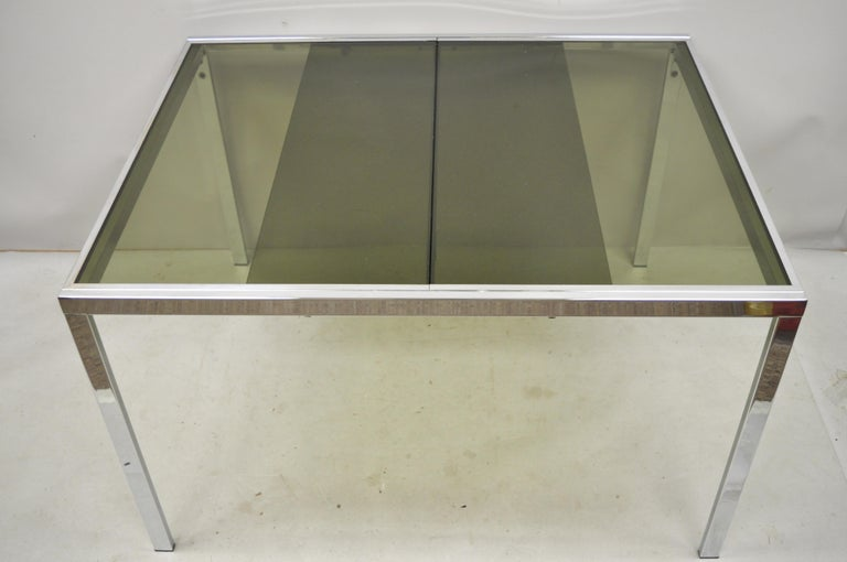 Midcentury Italian modern chrome and glass extension dining table. Item features a nice smaller size, chrome frame, extension sides with pop up leaf, original label, very nice vintage item, clean modernist lines, circa 1970s. Measurements: 28.5