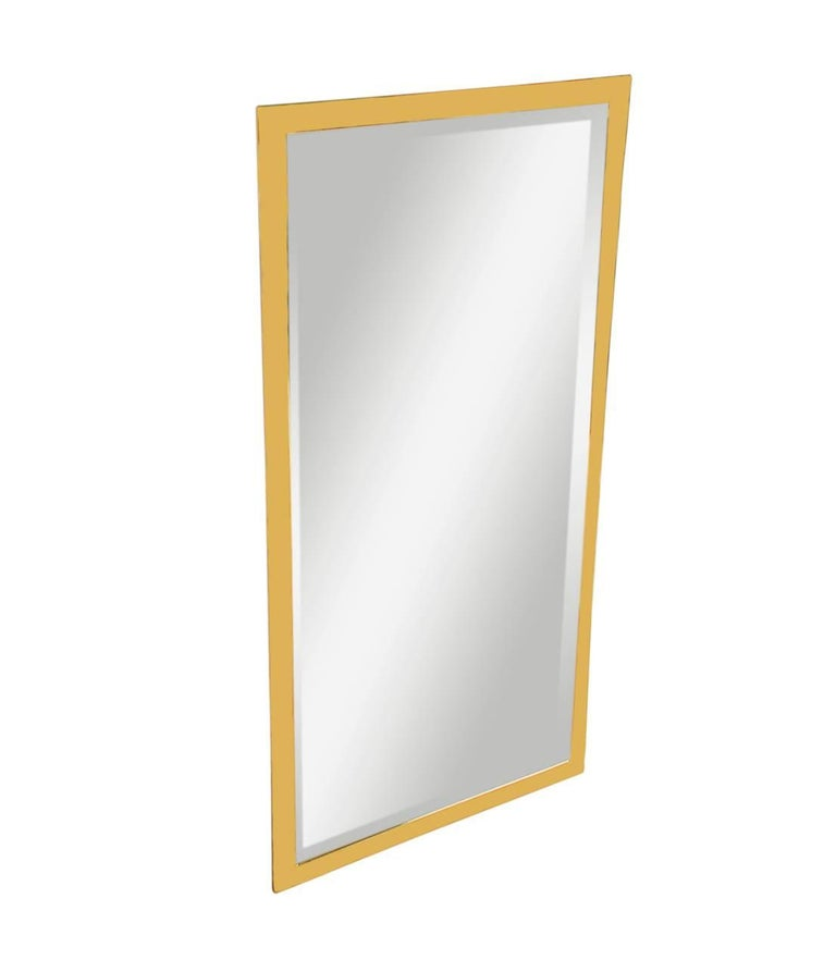 A well made, simple, and modern brass framed wall mirror made in Italy, circa 1970s. It features a heavy brass frame with inlaid beveled mirror.