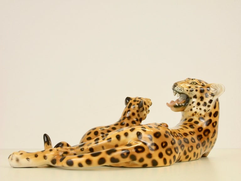 Vintage sublime fine hand painted porcelain statuette from Italy depicting a leopard mother playing with her cube.
