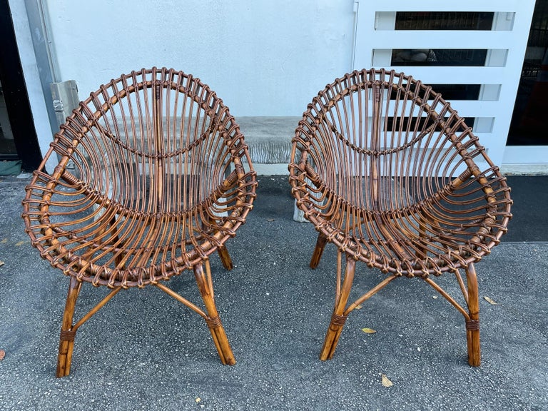 Bent bamboo and rattan for these wonderful scoop design chairs. These have some restoration work to return them to their beautiful original look. The sheepskins shown are only for sampling, they are not included. If you want to purchase them, we can