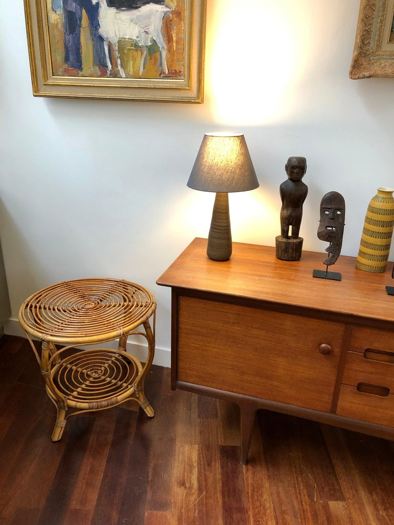 Italian rattan coffee / end table (circa 1960s). A very stylish piece with slews of character and charm. A rare rounded shape with two horizontal surfaces for storage or display set this characterful table apart from the others. The smart-looking