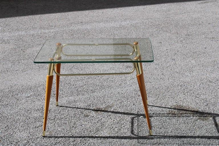 Midcentury Italian rectangular coffee table in brass and maple with glass top.
