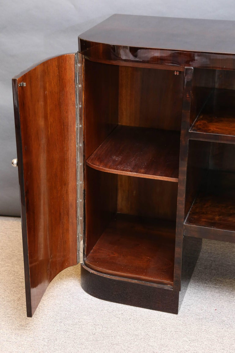 Beautiful sideboard has four spacious drawers on the right side and one big drawer with two shelves on the left side. Between them there are two wide shelves that are connecting right and left sides. Each of the drawers has a chrome handle.