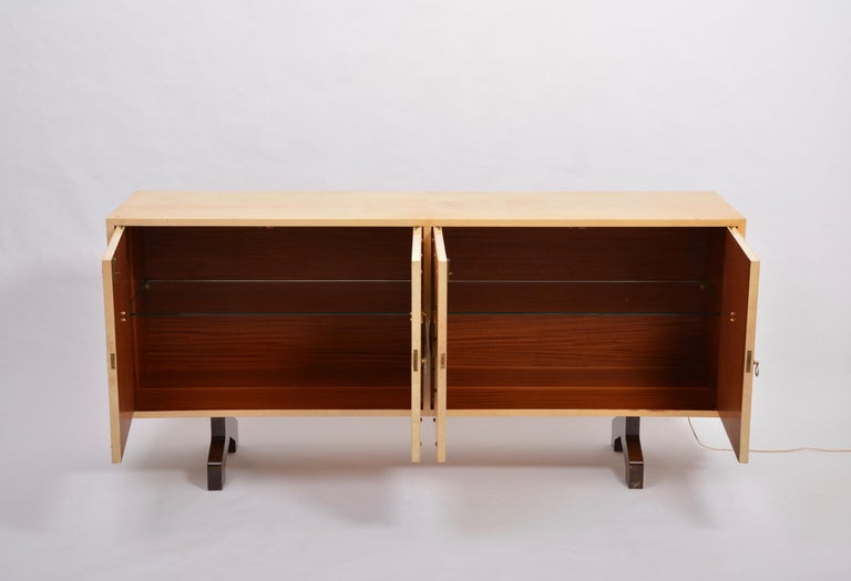 Midcentury sideboard in beige lacquered goat skin by Aldo Tura Sideboard with two hinged doors designed by Aldo Tura and produced in Italy in the 1970s. Wood covered with goatskin in a gorgeous beige color. Each compartment features with a loose