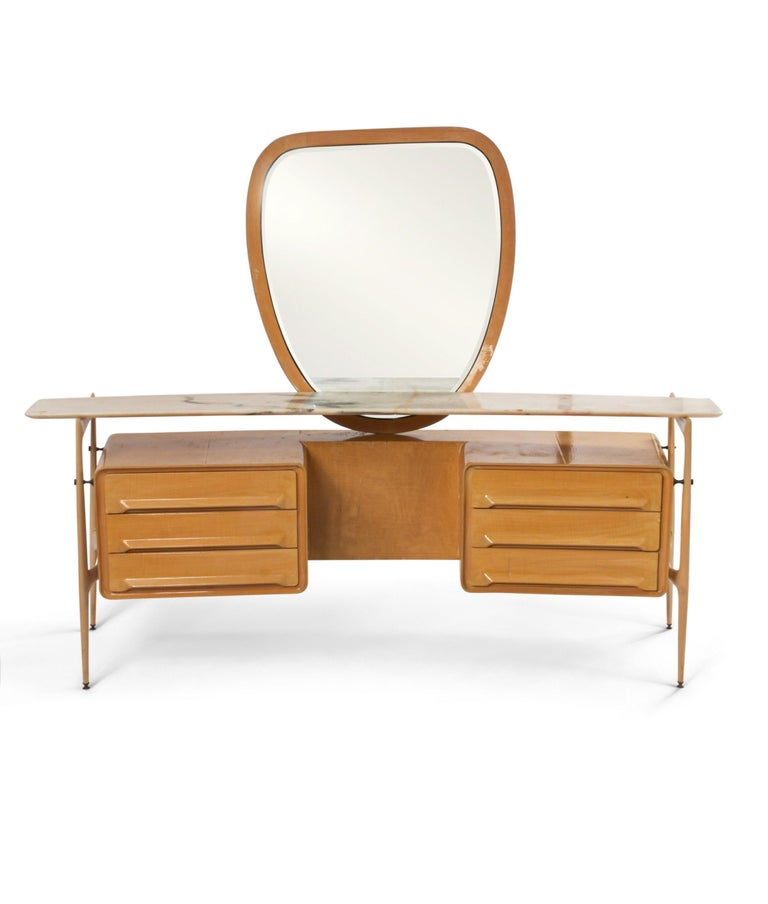 Midcentury Italian maple wood vanity with ovoid center mirror supported on a set of 6 drawers with a marble shelf (Silvio Cavatorta, circa 1950).