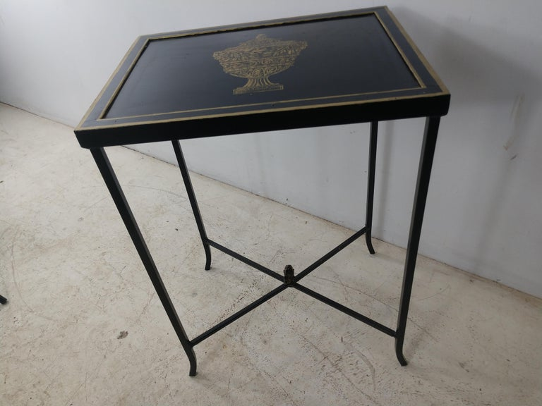 Simple and elegant toleware side table in black with gilt decorations. X-stretcher with acorn finial. This item can be parcel posted.