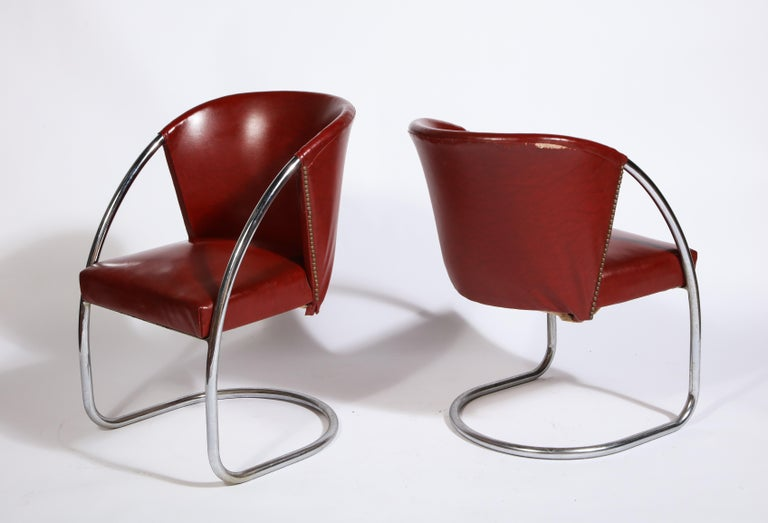 Midcentury Jacques Adnet set chrome chairs and table, France  Beautiful and rare table and chairs. The chairs can be reupholstered but left in original condition for authenticity. In overall good condition. Deep red leatherette chairs with chrome