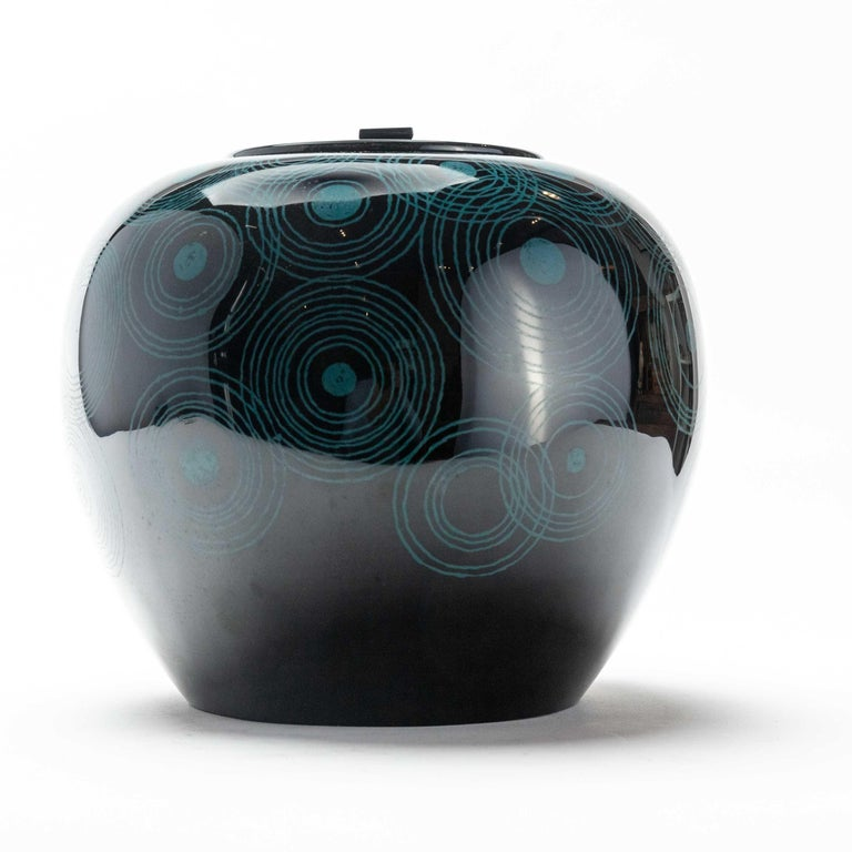 A stunning and curvaceous black lacquer mizusashi from Japan. Mizusashi are used in Japanese tea ceremony, as water containers. They are one of the main aesthetic components for a host to consider. This one features a stylish concentric circle