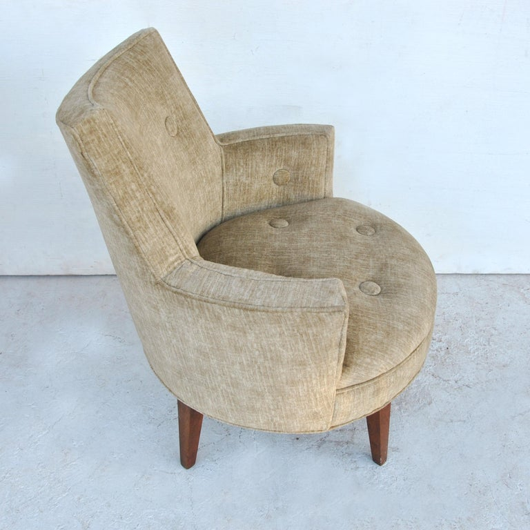 Mid century Jens Risom Style swivel lounge chair   Petite for small spaces yet roomy in the seat this lounge chair has Classic tufting and buttoned upholstery with tapered walnut legs. Swivel.