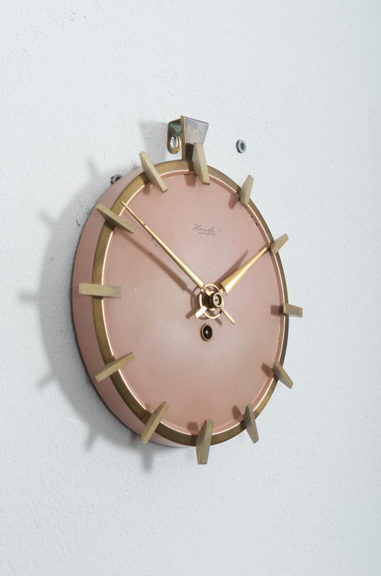 Brass construction with antique pink painted clock face from the early 1950s. Original mechanical movement but it can be changed to AAA-battery movement on request. Delivery time about 2-3 weeks. Some scratches on the clockface.