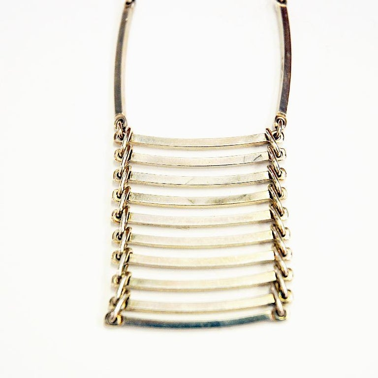 Wonderful pendant silver necklace Danish midcentury designer NE from in the 1960s, Denmark. With horizontal bars lying on top of each other like a little ladder. Slightly curved. Good vintage condition.  Measures: Pendant width ca 4 cm., depth 0.2