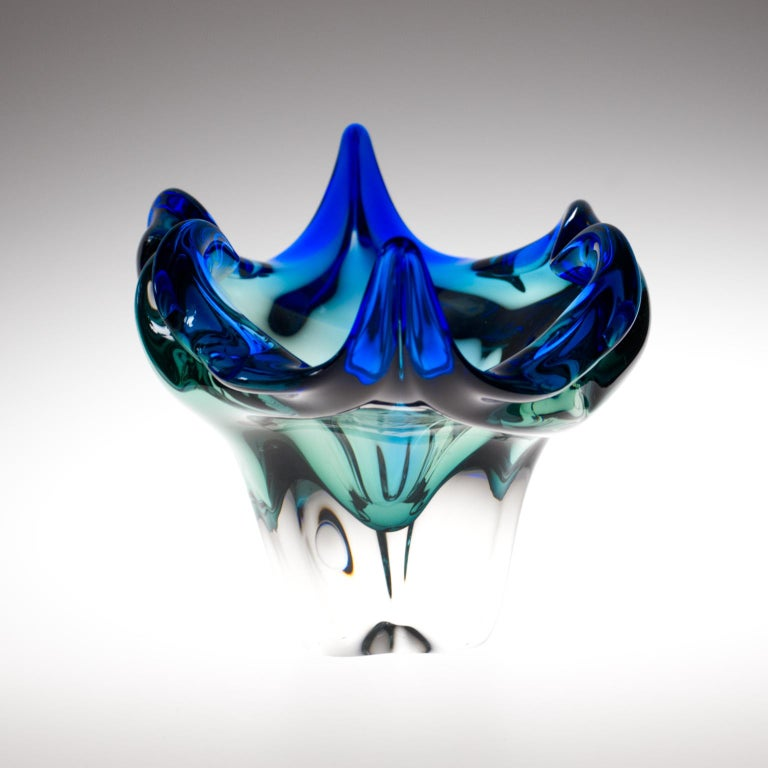 This highly sculptural winged bowl was designed by the talented Josef Hospodka for the Chribska Glassworks in 1960s. During his time as chief designer at Chribska.  The Chribska Glassworks has a celebrated history dating back to the 15th century.
