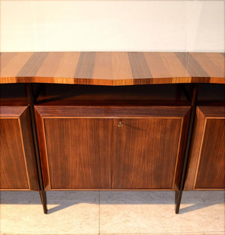 Mid-Century Modern Midcentury Large Italian Credenza in Three Sections Indian Cherry and Rosewood For Sale