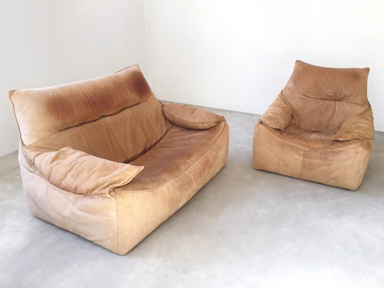 Amazing set of Mid-Century Modern leather seating group consisting a two and one-seat 'The Rock'. Designed by Gerard Van Den Berg for Montis, 1970s, Netherlands.  Original cognac brown leather upholstery.   Condition: Original condition. Lovely