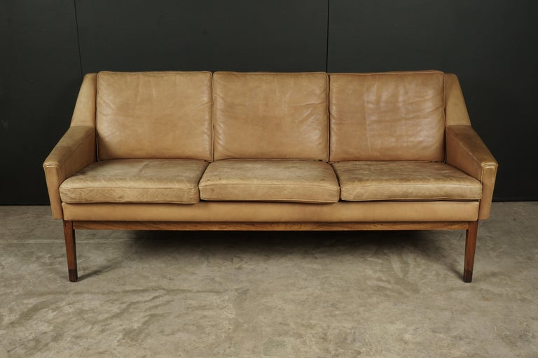 Midcentury leather sofa from Denmark, circa 1970. Original thick tan leather upholstery. Unknown designer. Very good quality and patina.