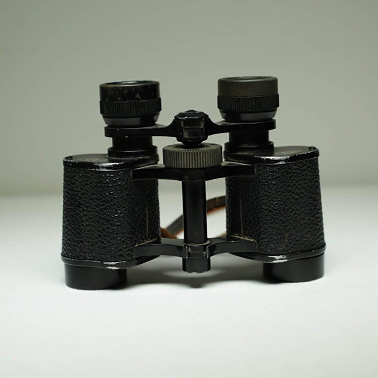 Leather wrapped metal binoculars by Palomar Paris with original leather strap, circa 1940-1950s. Work perfectly. Very clear viewing.